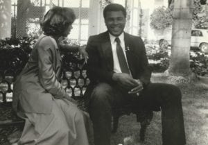 Tanya Hart and Muhammad Ali sitting on a bench